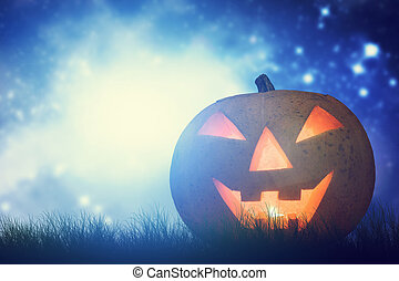Halloween pumpkin glowing in dark, misty scenery under night sky and moon
