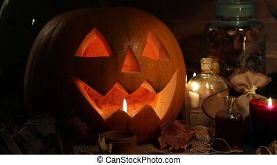 Halloween pumpkin head jack lantern with burning candles....
