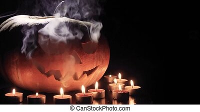Halloween pumpkin head jack lantern with burning candles...