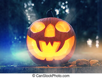 Halloween pumpkin in a forest at night