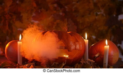 Halloween pumpkin in the smoke - Halloween pumpkin on autumn...