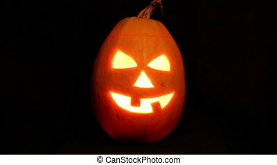 Halloween pumpkin jack-o-lantern candle lit, isolated on...