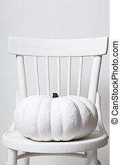 halloween pumpkin on a chair