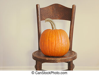 Halloween Pumpkin on a vintage chair