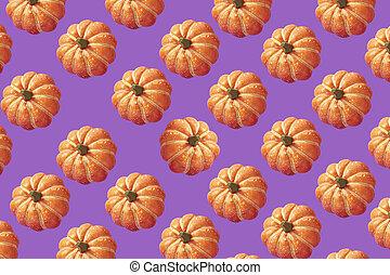 halloween pumpkin on purple background
