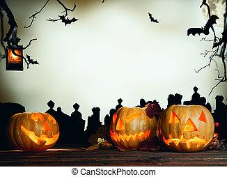 Halloween pumpkin on wood with dark background - Concept of...