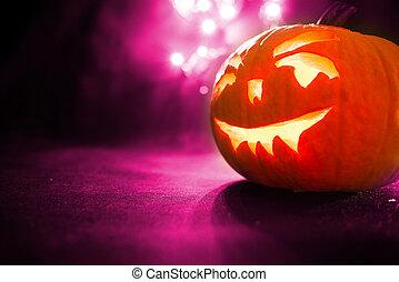 Halloween pumpkin with purple bokeh background
