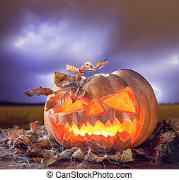 Halloween pumpkin with stormy sky on background