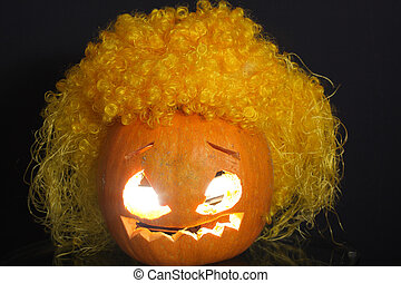 Halloween pumpkin with yellow curled hairs