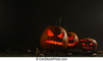 Halloween pumpkins and candles - Halloween pumpkins head ...