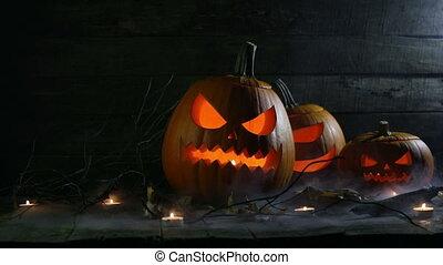 Halloween pumpkins and candles - Halloween pumpkins head...