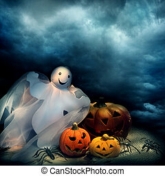 Halloween pumpkins and ghost at night