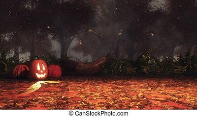 Halloween pumpkins in autumn forest at misty night