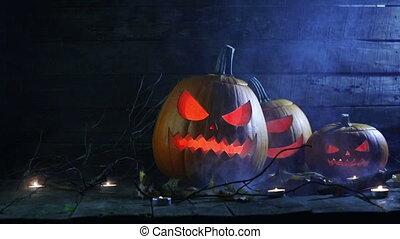 Halloween pumpkins in mist - Halloween pumpkins head jack o...
