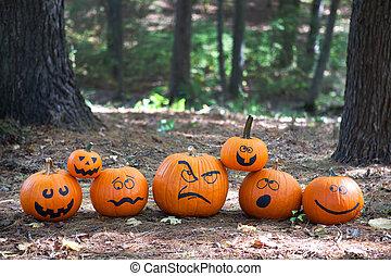Halloween pumpkins in the woods