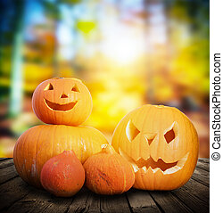Halloween pumpkins on autumn forest background