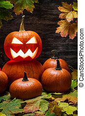 Halloween pumpkins on autumn leaves