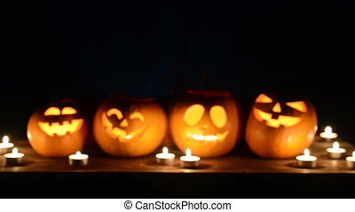 Halloween pumpkins on black background