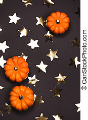 Halloween pumpkins on dark background with stars