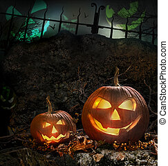 Halloween pumpkins on rocks  at night