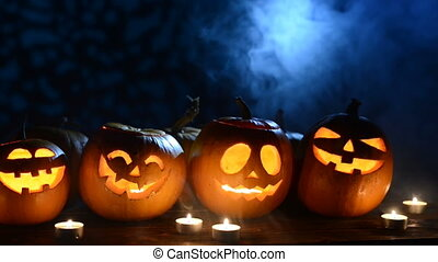 Halloween pumpkins on smoky background
