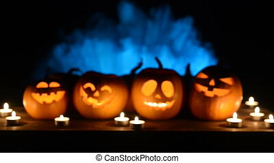 Halloween pumpkins on smoky background - Halloween pumpkins...