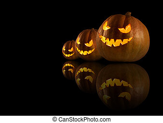 Halloween pumpkins on the dark background.