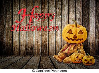 Halloween Pumpkins on wood background with message 'Happy Halloween'