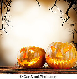 Halloween pumpkins on wood with dark background