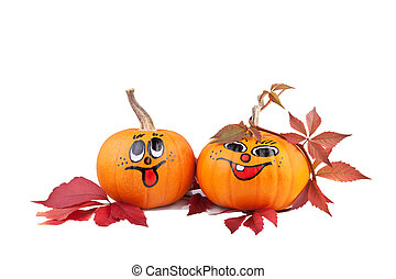 Halloween pumpkins with autumn leaves isolated on white