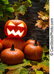 Halloween pumpkins with autumn leaves