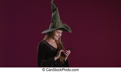Halloween Purchase Presents on Smartphone - Woman using...