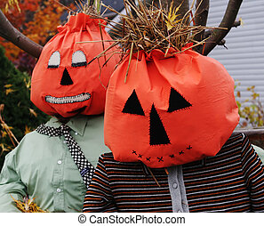 Halloween scarecrows in a garden