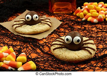 Halloween spider cookies on an orange and black background...