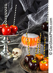 Halloween - Table with colored candy apples for Halloween...