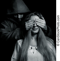 Halloween surprise - evil man behind innocent girl -...