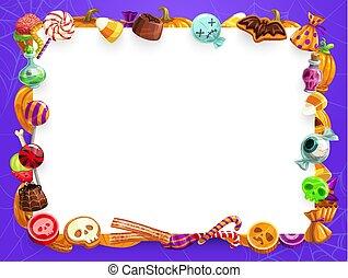 Halloween sweet treats, candies and pumpkin frame