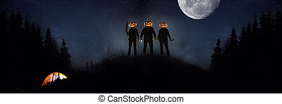 Halloween theme: scary maniacs with pumpkin head in dark forest