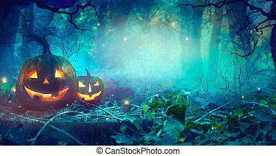 Halloween theme with pumpkins and dark forest.  Halloween design