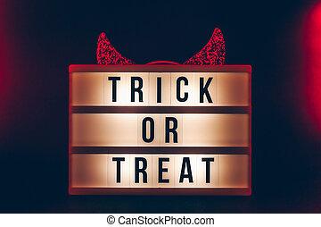 Halloween themed cinema light box on the dark toned ...