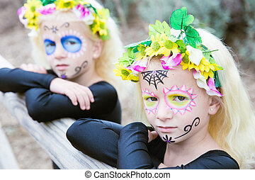 Halloween twin sisters with sugar skull makeup