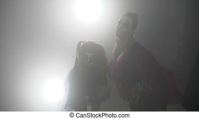 Halloween vampire clown and horror skull doll frightening and biting and screaming with mouths wide open in slow motion