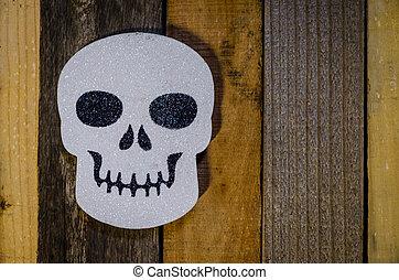 Halloween white skull on rustic background