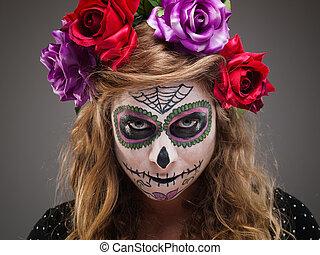 Halloween witch. Beautiful woman wearing santa muerte mask...