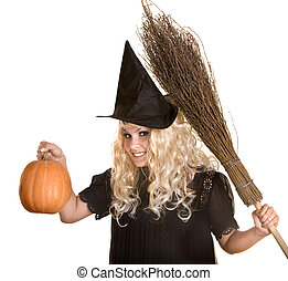 Halloween witch blond in black hat and dress with pumpkin on broom.
