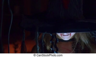 Halloween witch in a hat screaming scary.