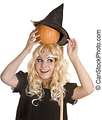 Halloween witch in black hat  with pumpkin on broom.
