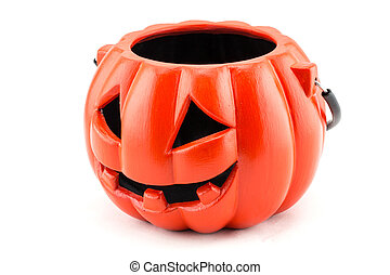 Halloween with ceramic pumpkin on white background