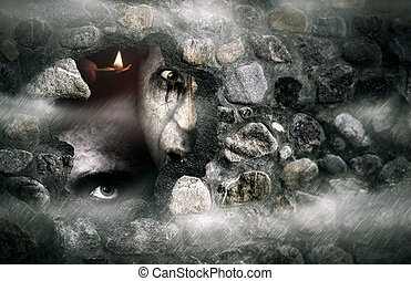 Halloween zombies - Halloween concept of a broken stone wall...