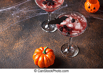Halloweens spooky drink. Cocktail with blackberry